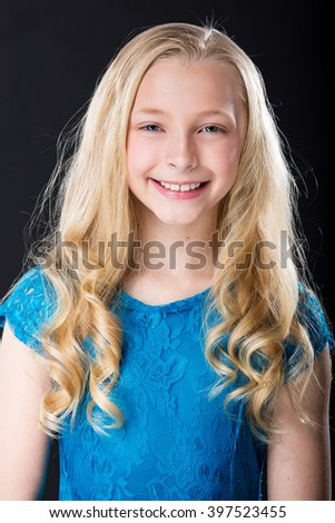 Portrait of a pretty young girl with blonde hair - stock photo