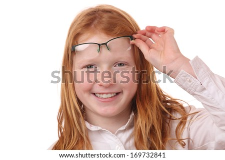 Portrait of a pretty young girl with glasses on white background - stock photo