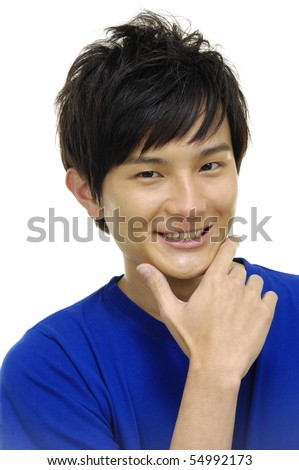 Portrait of a pretty young guy with hand at his chin - stock photo