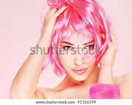 Portrait of a pretty young pink hair woman - stock photo