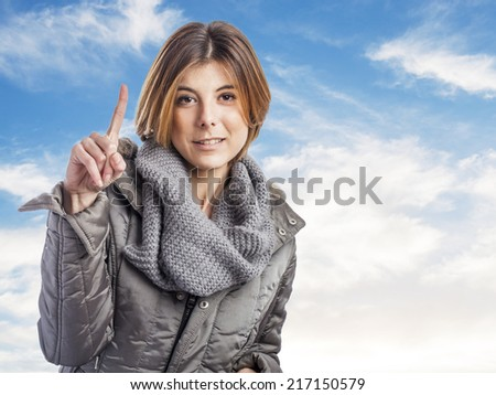 portrait of a pretty young woman doing the number one gesture - stock photo