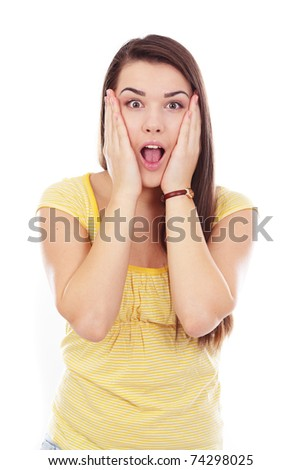 Portrait of a pretty young woman looking surprised against white background - stock photo