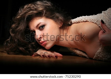 Portrait of a pretty young woman relaxing on the floor