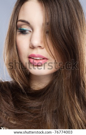 Portrait of a pretty young woman with beautiful hair
