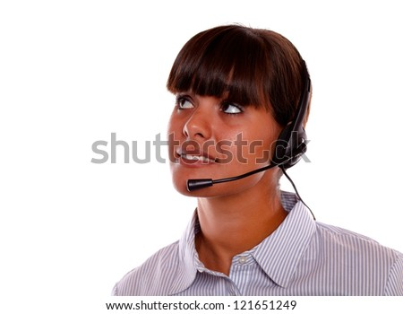 Portrait of a pretty young woman with earphone looking up on isolated background copyspace - stock photo