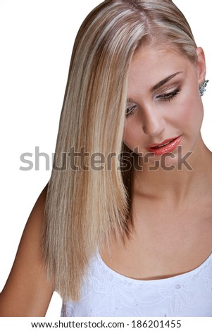 Portrait of a pretty young woman with long blond hair and closed eyes on white background - stock photo