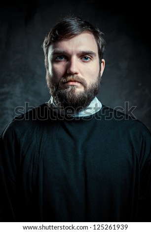 Portrait of a priest - stock photo