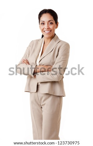Portrait of a professional Hispanic business woman wearing a tan suit looking at camera isolated on white - stock photo