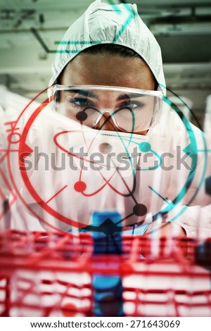 Portrait of a protected science student dropping liquid in a test tube against science and medical graphic - stock photo
