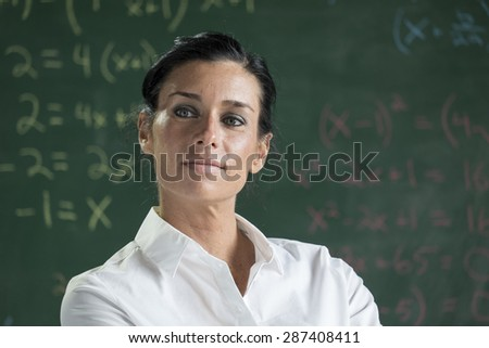 Portrait of a proud teacher - stock photo