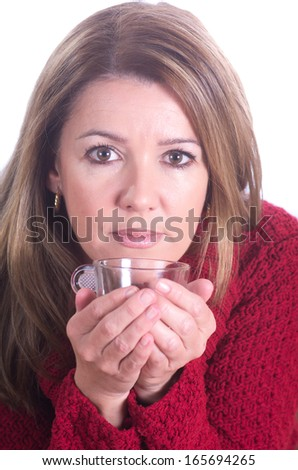 portrait of a real woman drinking coffee on white background - stock photo