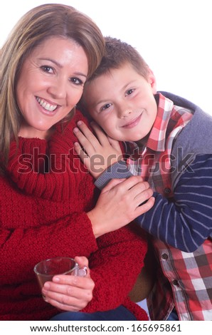 portrait of a real woman having coffee with her son on white background - stock photo