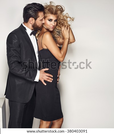Portrait of a really attractive couple in sensual pose - stock photo