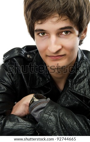 Portrait of a rebel type guy in classic leather jacket against w