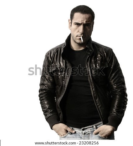 Portrait of a rebel type guy in classic leather jacket with cigarette in mouth against white background - stock photo