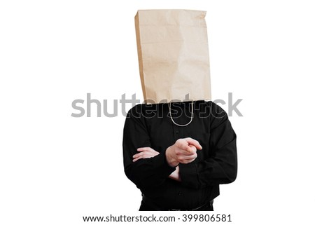 Portrait of a red-bearded, balding male brutal. White isolated background. Black shirt and pants. Paper bag over head. Dissatisfied with the situation  with arms folded, finger at viewer. - stock photo