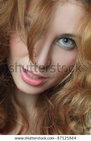 Portrait of a red-haired, blue-eyed girl on white background