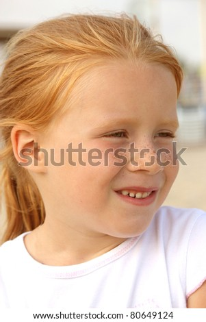 portrait of a red-haired little girl - stock photo