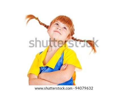 Portrait of a red-haired little girl with her arms crossed - stock photo