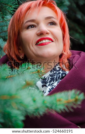 Portrait of a redheaded woman in autumn. beautiful woman in autumn park. Closeup outdoors portrait of  woman wearing autumn outfit. portrait of a beautiful girl in the autumn on walk.