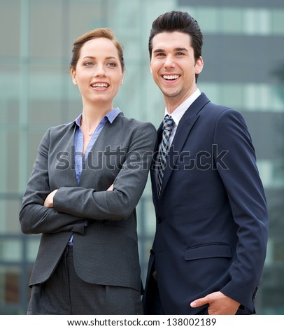 Portrait of a relaxed businessman and business woman smiling - stock photo