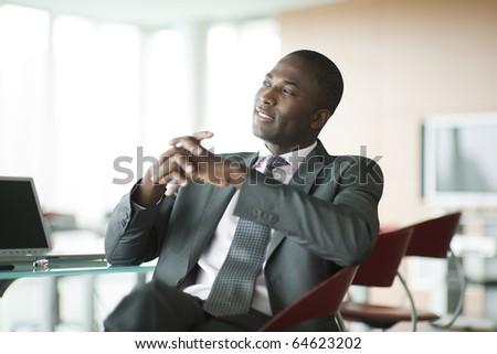 Portrait of a relaxed businessman looking away - stock photo