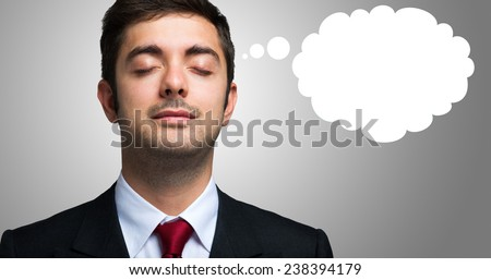 Portrait of a relaxed businessman with closed eyes and a white balloon - stock photo