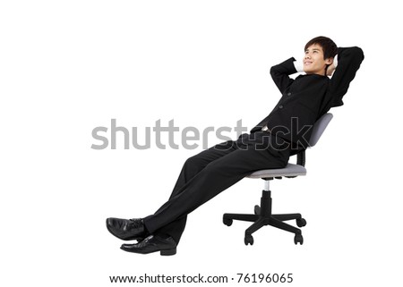 Portrait of a relaxed young businessman sitting on the chair and isolated on white - stock photo