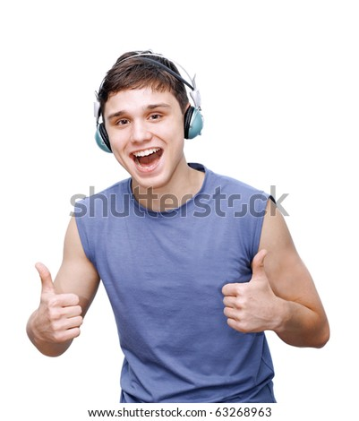 Portrait of a relaxed young man listening to music on headphone against white background - stock photo