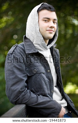 portrait of a relaxing boy wearing a hoodie - stock photo