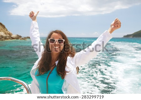 Portrait of a relaxing happy woman on the upper deck of a cruise ship - stock photo