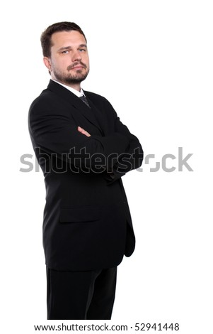 Portrait of a representative business man standing with crossed arms - stock photo