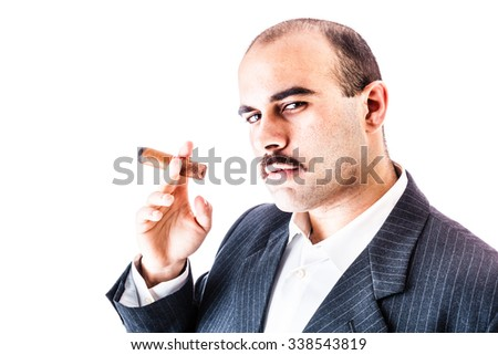 portrait of a rich businessman smoking a big cigar isolated over a white background - stock photo