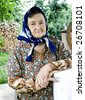 Portrait of a romanian old woman in the countryside - stock photo