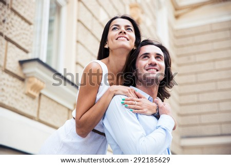 Portrait of a romantic couple looking away outdoors