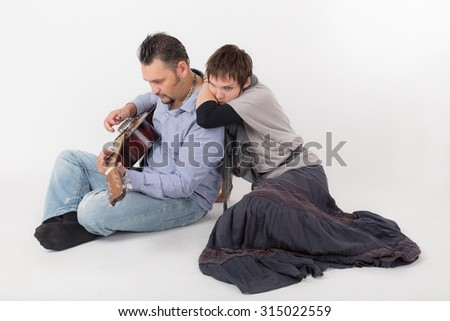 portrait of a romantic couple with guitar