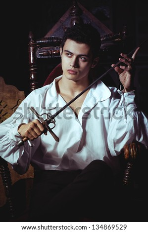 Portrait of a romantic man with a sword - stock photo