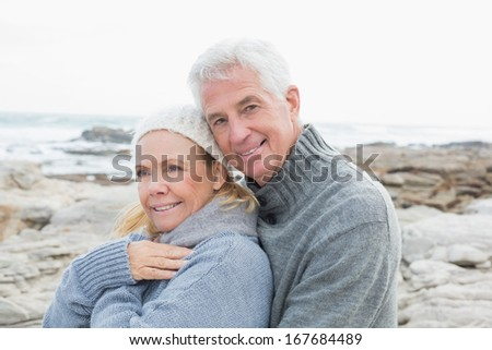 Portrait of a romantic senior couple together on a rocky beach