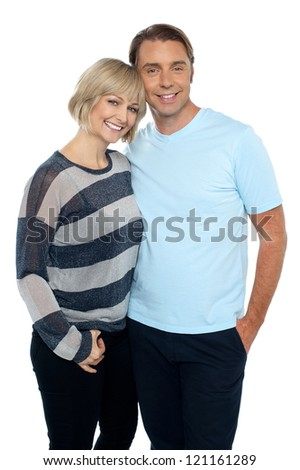 Portrait of a romantic young couple standing together over white background. - stock photo