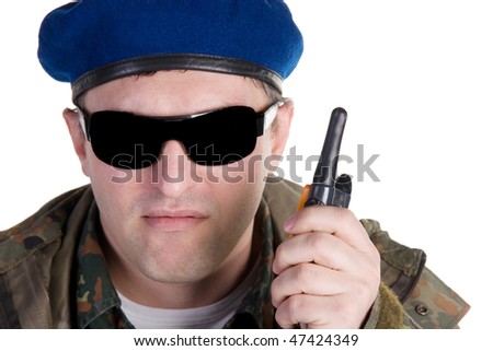 Portrait of a Russian paratrooper with a walkie-talkie (isolated on white) - stock photo