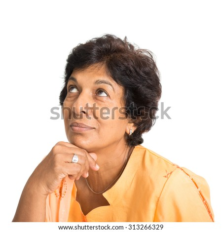 Portrait of a 50s Indian mature woman smiling and looking up having a thought, isolated on white background. - stock photo