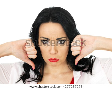 Portrait of a Sad Angry Upset Beautiful Young Hispanic Woman Giving a Thumbs Down Sign - stock photo