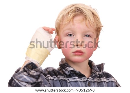 Portrait of a sad child with his hand hurt - stock photo