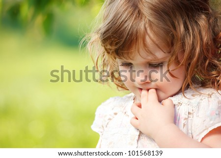 Portrait of a sad curly little girl - stock photo