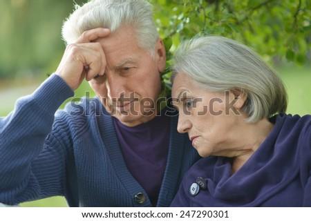 Portrait of a sad elder couple outdoor - stock photo
