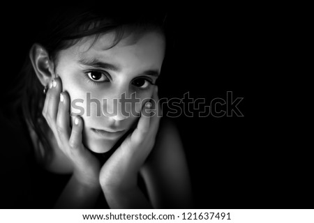 Portrait of a sad hispanic girl in black and white with space for text - stock photo