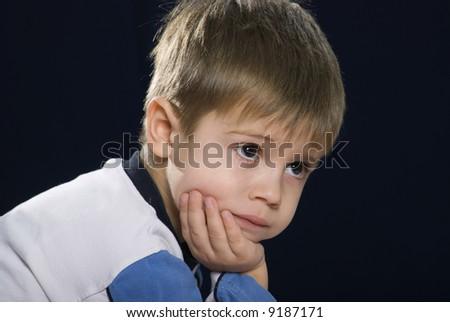 portrait of a sad little boy a great person - stock photo