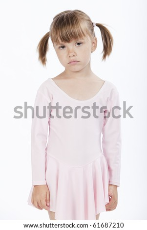 Portrait of a sad little girl wearing pink outfit - stock photo