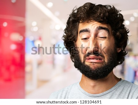 Portrait Of A Sad Man at the mall - stock photo