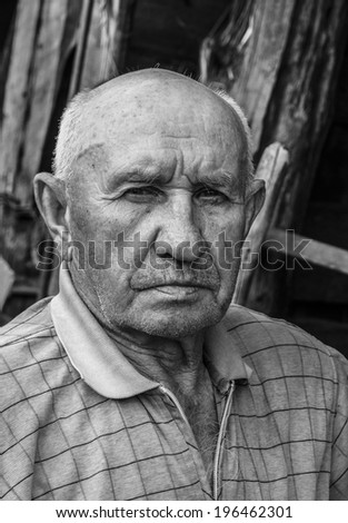 portrait of a sad old man - stock photo